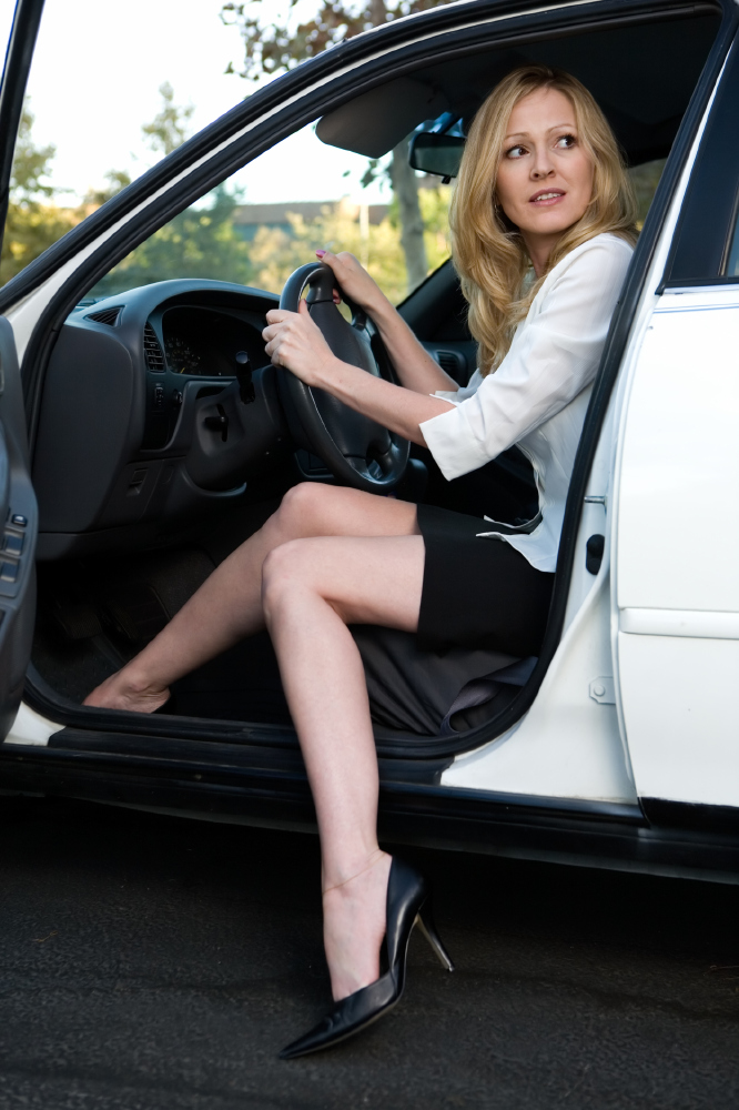 young women driving car flip flops
