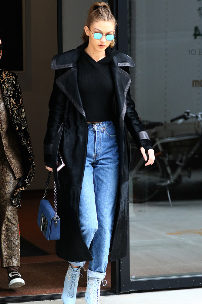 Gigi Hadid in a modern, leather lined, black trench coat