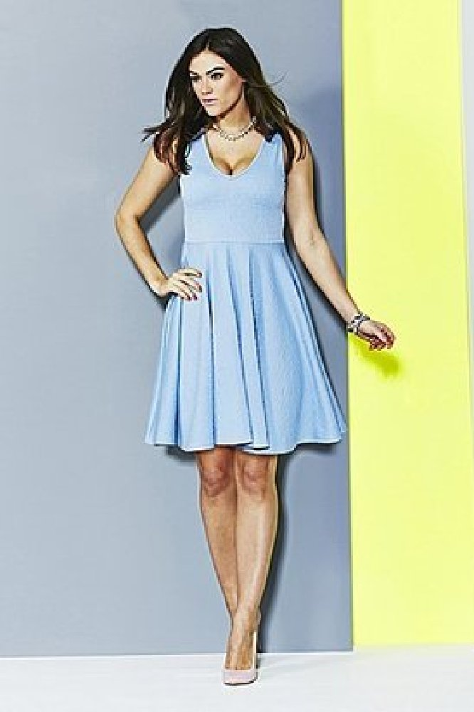 7cf524e90f7 We love this simple skater dress that can be dressed up for a wedding with  accessories
