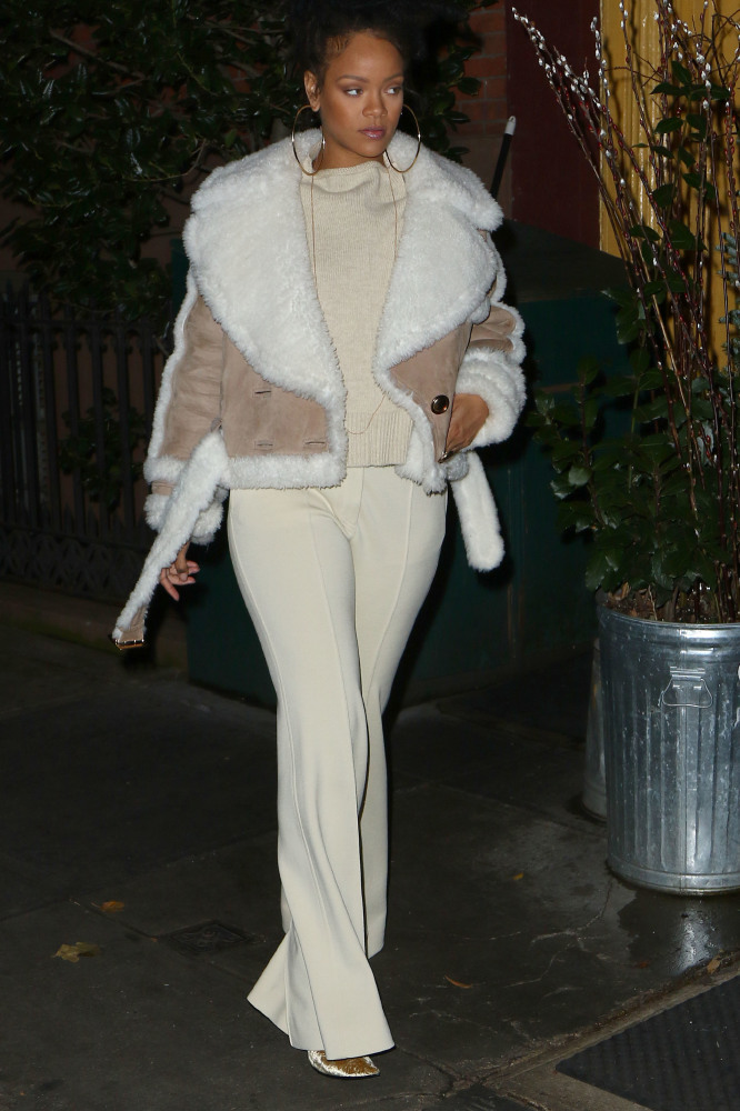 Rihanna rocking Burberry's suede shearling aviator jacket