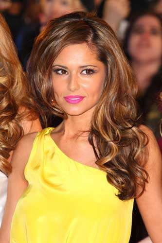 Cheryl Cole flutters her long lashes