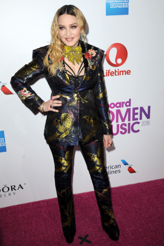 Madonna in a custom printed Gucci suit