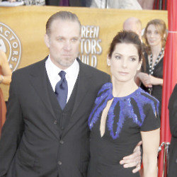 Jesse James and Sandra Bullock (Credit: Famous)