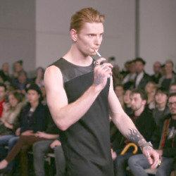 Models smokes e-cig on the Ada + Nik runway