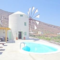 Green windmill villa in Santorini