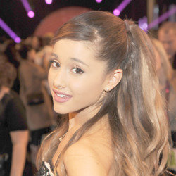 Ariana Grande covers up badly damaged hair with extensions