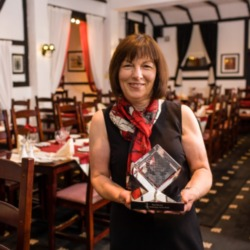 Owner of The Robertson Arms with her award