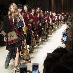 Cara Delevingne leads a storm of models at Burberry Prorsum AW14
