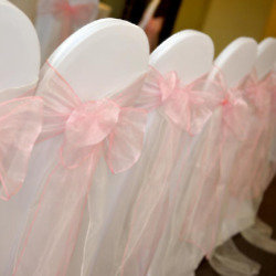 Chair cover with pink sash