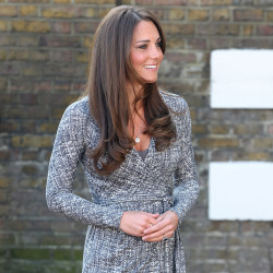 Kate Middleton dresses her growing baby bump in a chic wrap dress