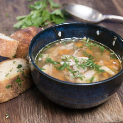 Organic chicken soup with tarragon garlic bread