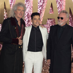 Rami Malek with Brian May and Roger Taylor at the Bohemian Rhapsody world premiere / Photo Credit: JW/Famous