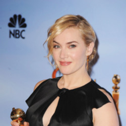 Kate Winslet shows off award