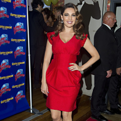 Kelly Brook knows how to work a red dress