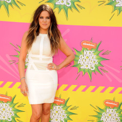 Khloe Kardashian looked hot in her white figure-hugging dress