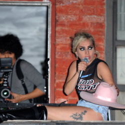 Lady Gaga pictured on a NYC apartment fire escape during filming for 'Joanne' promo