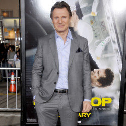 Liam Neeson in a suit because we can't hear him!