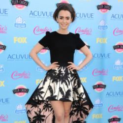 Lily Collins looks beautiful in her bold skirt