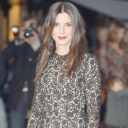 Sandra Bullock wears Stella McCartney black lace dress