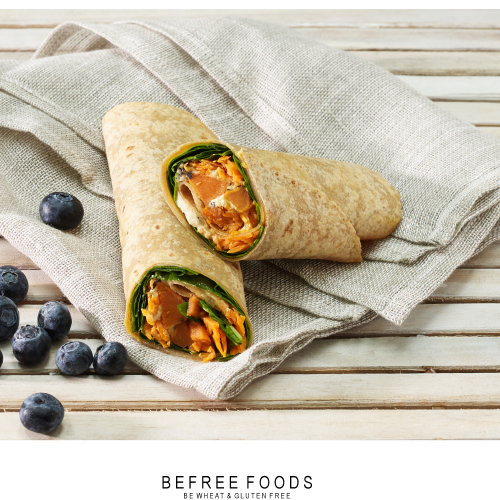 Sweet Potato Wrap with grated carrot, roasted sweet potato, red pepper, hummus and spinach
